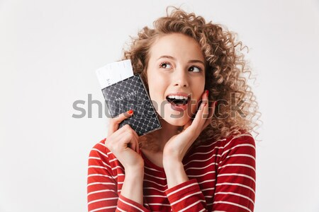 Happy young lady indoors with gift boxes. Stock photo © deandrobot