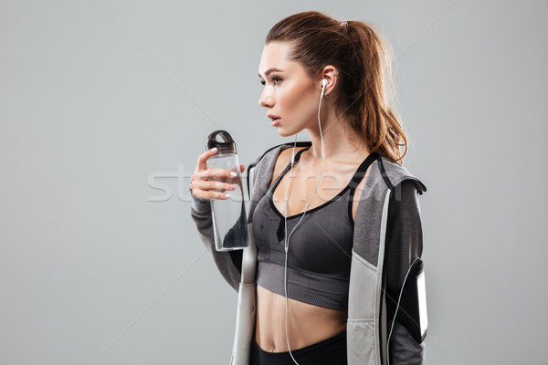 Side view of a female runner with water Stock photo © deandrobot