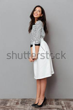 Full-length shot of asian woman showing thumb up Stock photo © deandrobot