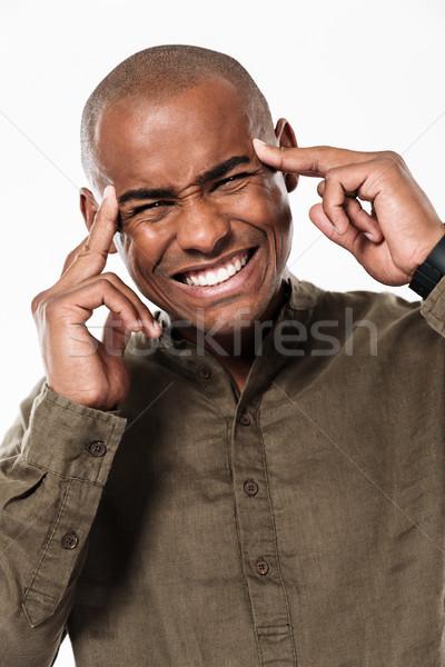 Elégedetlen fiatal afrikai férfi fejfájás kép Stock fotó © deandrobot