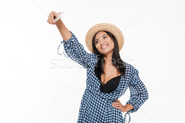 Stock photo: Portrait of a smiling attractive asian woman in dress