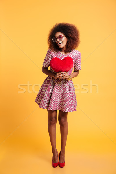 Full length portrait of a smiling happy afro american woman Stock photo © deandrobot