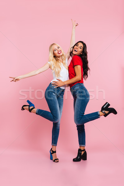 Stock photo: Full length image of two cheerful women rejoice