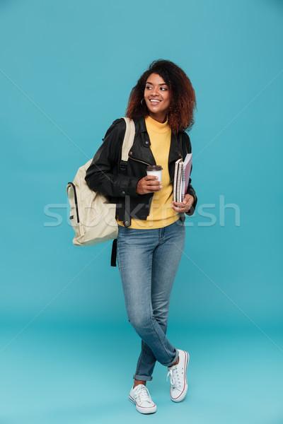 Imagen sonriendo África mujer chaqueta de cuero Foto stock © deandrobot