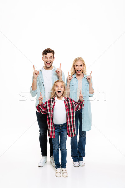 Full length portrait of a happy cheerful young family Stock photo © deandrobot