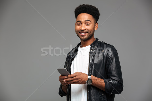 Close-up portrait of cheerful african guy with stylich haircut h Stock photo © deandrobot