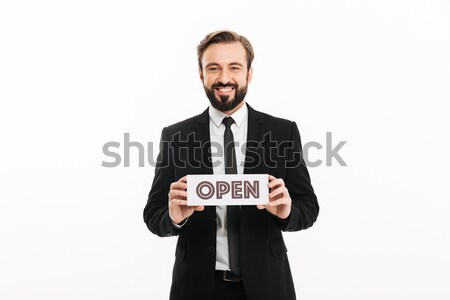 Confused bearded business man with empty purse looking at camera Stock photo © deandrobot
