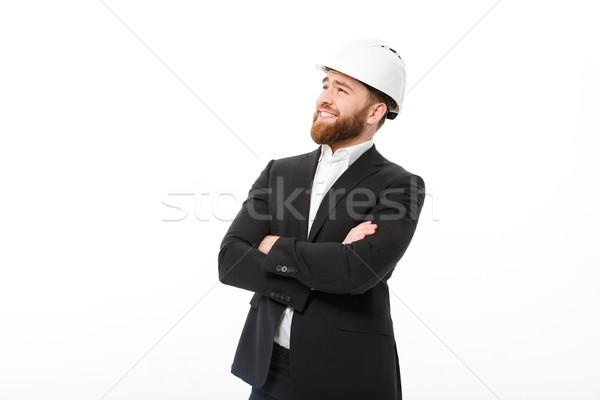 Sorridente barbudo homem de negócios capacete brasão Foto stock © deandrobot