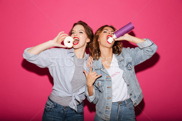 Amazing two women friends eating sweeties Stock photo © deandrobot