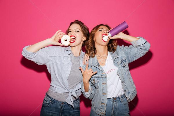 Elképesztő két nő barátok eszik kép izolált Stock fotó © deandrobot