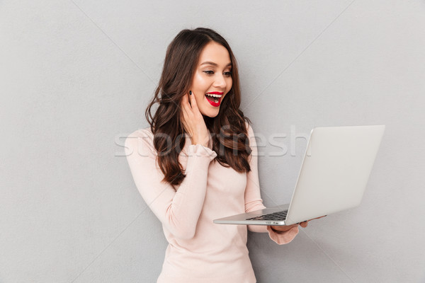 Portrait of satisfied and happy woman with red lips watching fas Stock photo © deandrobot