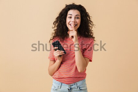 Portrait of a cheery young girl Stock photo © deandrobot