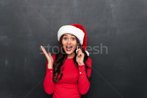 удивленный счастливым брюнетка женщину красный блузка Сток-фото © deandrobot