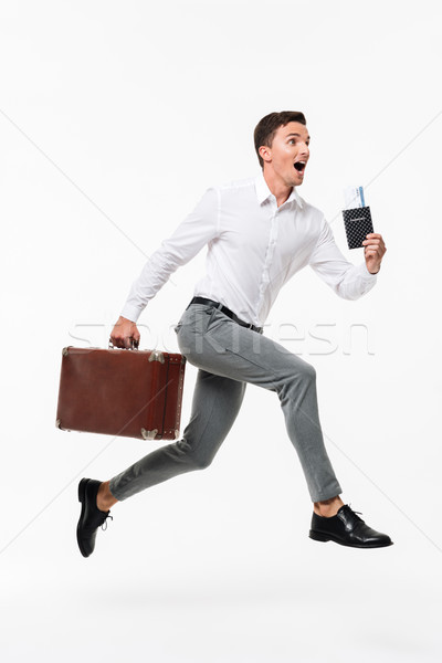 Stock photo: Full length portrait of an amused happy man in white shirt