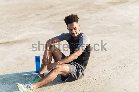 Handsome sportsman make sport exercises outdoors early morning. Stock photo © deandrobot