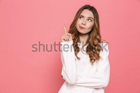 Portrait of a pensive asian businesswoman Stock photo © deandrobot