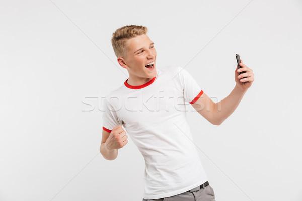 Foto gelukkig jongeling schreeuwen Stockfoto © deandrobot