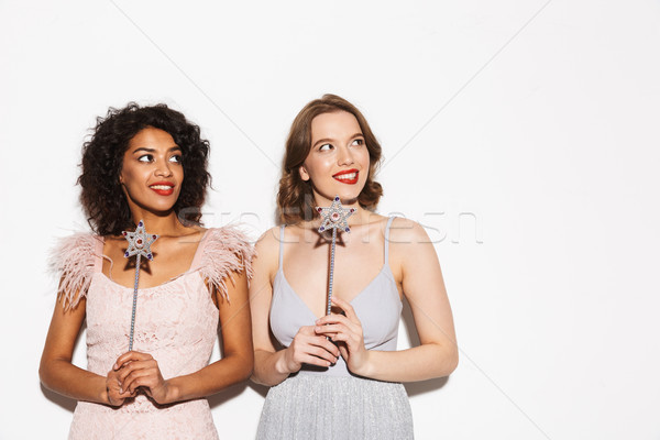 Portrait of two pretty well dressed women having fun Stock photo © deandrobot