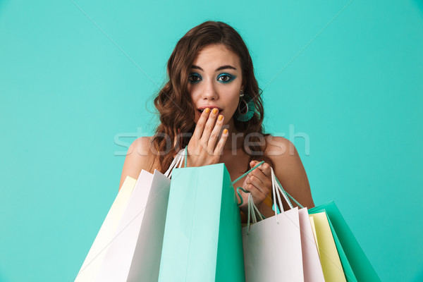 Photo of trendy young girl 20s wearing fashion style holding col Stock photo © deandrobot