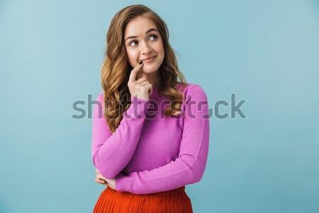 Derűs nő ül asztal szürke lány Stock fotó © deandrobot