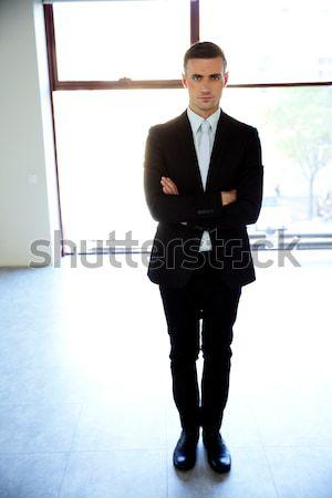 портрет бизнесмен ходьбе изолированный белый служба Сток-фото © deandrobot