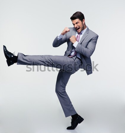 Funny businessman jumping in air Stock photo © deandrobot