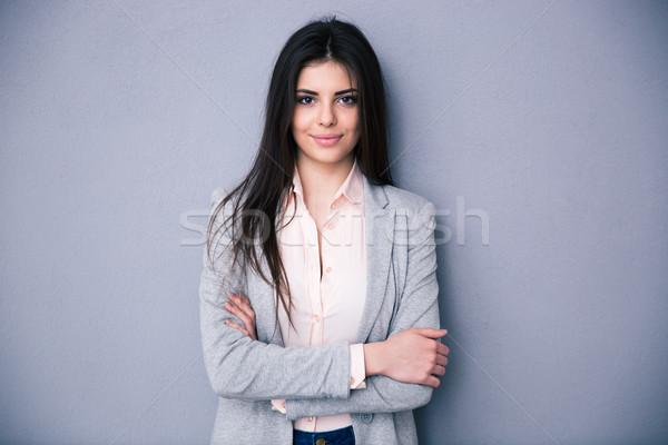 美しい かわいい 女性 腕 折られた 立って ストックフォト © deandrobot