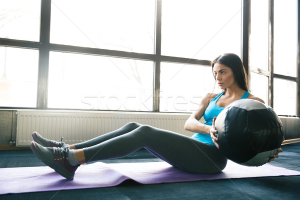 Young beautiful woman working out with fit ball Stock photo © deandrobot