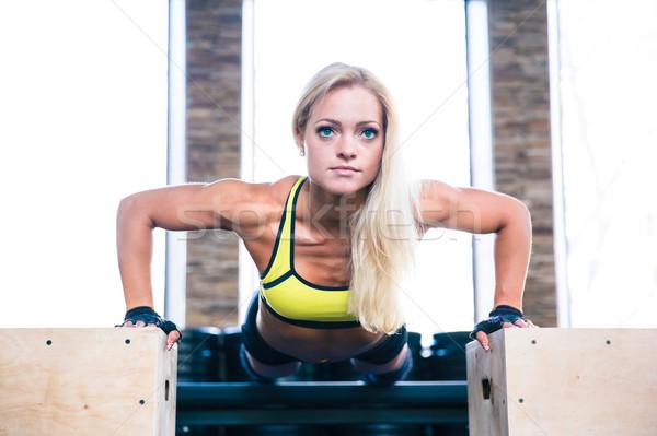 Beautiful sports woman doing push ups on fit box Stock photo © deandrobot
