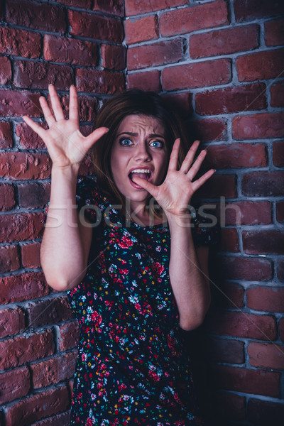 Portrait of a frightened young woman Stock photo © deandrobot