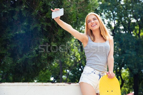 счастливая девушка скейтборде фото счастливым Сток-фото © deandrobot