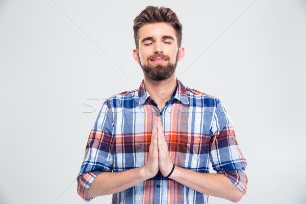 Portrait of a handsome man praying  Stock photo © deandrobot