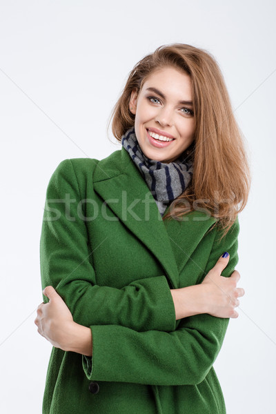 Smiling fashion woman in coat Stock photo © deandrobot
