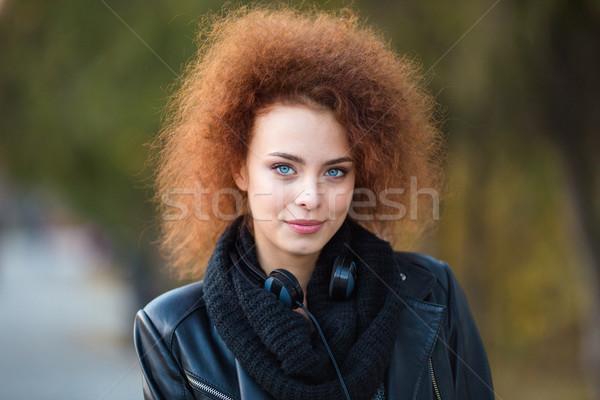 Kadın kıvırcık saçlı açık havada portre genç Stok fotoğraf © deandrobot