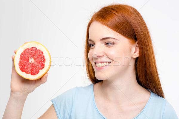 Gülen genç mutlu kadın bakıyor Stok fotoğraf © deandrobot