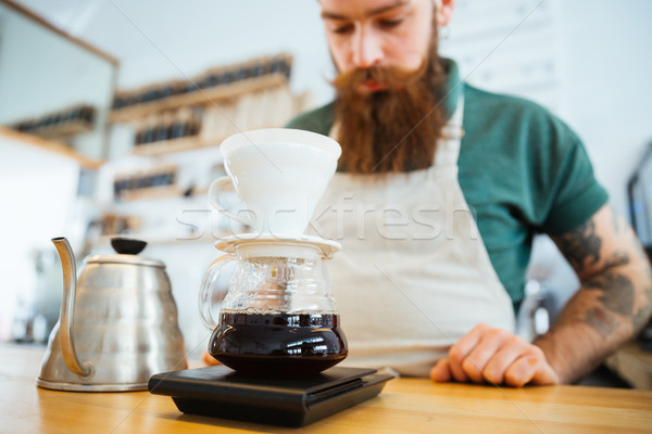 Barista preparing coffee Stock photo © deandrobot