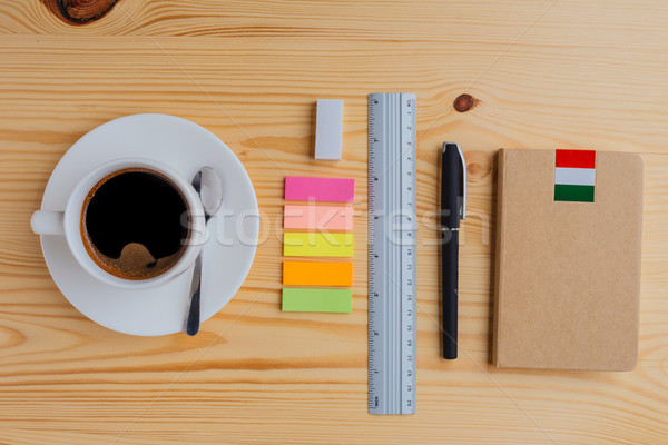Office supplies and cup of coffee on the table Stock photo © deandrobot