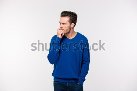 Peinzend toevallig man permanente geïsoleerd witte Stockfoto © deandrobot