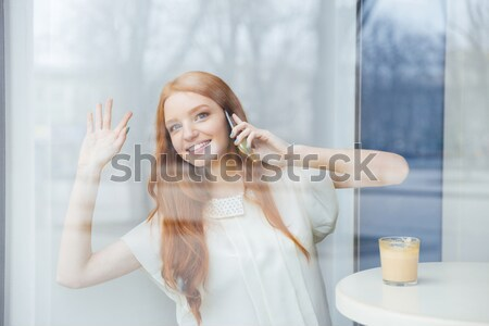 Happy woman lying on the bed and waking up Stock photo © deandrobot