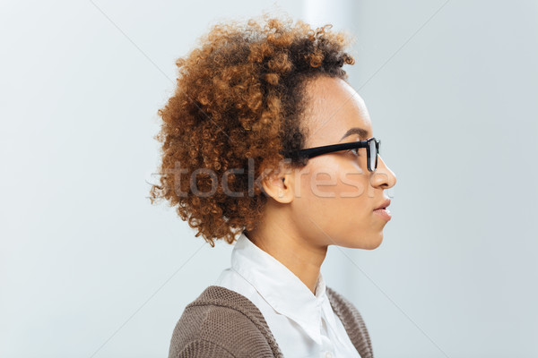 Profile of african american businesswoman in glasses  Stock photo © deandrobot