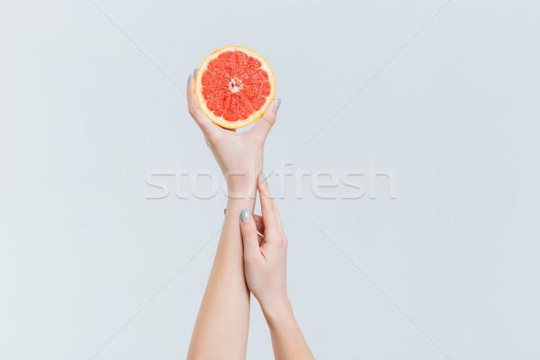 Femenino manos pomelo aislado blanco Foto stock © deandrobot
