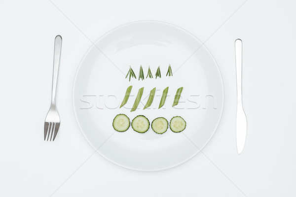 Top view of cucumber, rosemary and asparagus on the plate Stock photo © deandrobot