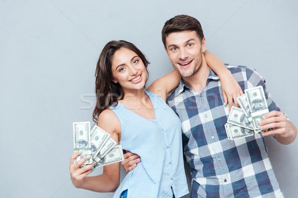 Foto stock: Casal · dinheiro · cinza · feliz