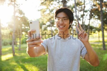 человека рюкзак колба ходьбе лес улыбаясь Сток-фото © deandrobot