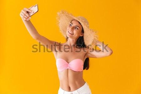 Fiatal gyönyörű nő citromsárga matrac koktél izolált Stock fotó © deandrobot
