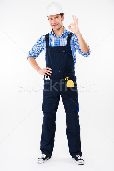 Happy man foreman in helmet standing and showing ok gesture Stock photo © deandrobot