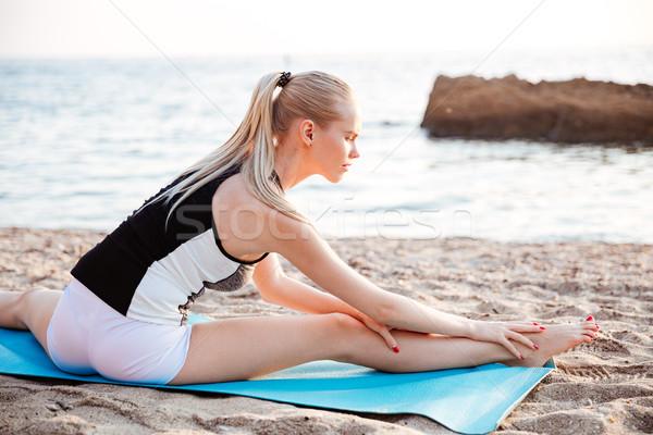 Genç sarışın kadın yoga mat portre açık havada Stok fotoğraf © deandrobot