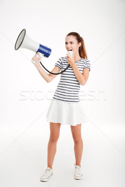Tam uzunlukta portre genç kadın megafon yalıtılmış Stok fotoğraf © deandrobot