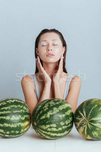 Gyönyörű fiatal nő csukott szemmel friss víz arc Stock fotó © deandrobot