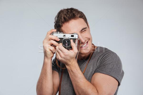 Portré fiatalember fotós kamera elvesz fotó Stock fotó © deandrobot